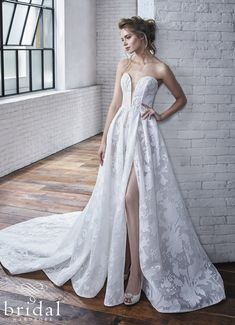 Sweet and romantic, this A-line wedding gown features a unique burn-out print organza giving depth to the gown's print. Edgy yet feminine, its low plunging sweetheart line and high leg slit tells a story of adventure. Complete with an invisible zipper, this is truly a one-of-a-kind gown. Carina is available at Bridal Wardrobe to buy or rent come to us for timeless elegance and the manor of all bridal wear. We hire out exclusive brand name wedding weddings. Bringing luxury bridal wear to… Allure Couture, Vows Bridal, Blush Bridal, Bridal Salon, Designer Wedding Dresses, Bridal Dresses, Girls Dresses, Bridal Gown, Monique Lhuillier