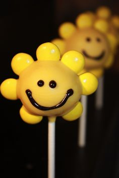 Sunshine Cake Pop*Dip cake ball, then stick in yellow m's. Melt chocolate pieces & using a toothpick draw face.