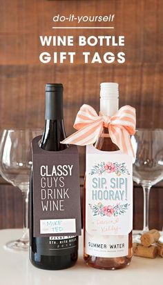 Two bottles of wine with wine tags