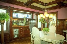 Magnificent 1912 Historic home overlooking Hays Park. Meticulously maintained & lovingly restored w/period perfect box beams ceilings, chandeliers & wonderful woodwork in Huge Living room & Dining Room w/built in Buffet.