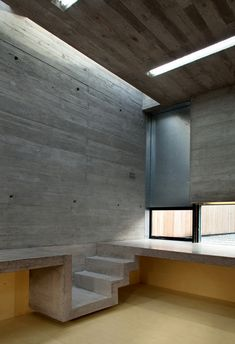 John Graham artist's studio, Dublin, Architecture Republic, concrete ribbon wrapping around room, board marked formed concrete walls