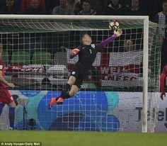 England goalkeeper Joe Hart makes an  excellent save against Sloveniain a World Cup qualifier October 2016