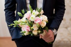 Pink pastel bouquet in grooms hands by Wedphoto on Creative Market