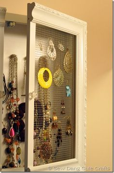 DIY jewelry medicine cabinet. Organize all your earrings and necklaces in one place!
