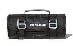 "Velomacchi Speedway Toll Roll -- Tools and spare parts everywhere, no organisation or system, just a plastic bag to keep all this stuff together. If this sounds like you then a tool roll could be your next purchase. The Velomacchi Speedway Tool Roll has two adjustable webbing straps to securely close the tool roll. When open, tools are set out for easy access thanks to a ""tool organisation system"" with pockets and loops, and a side compartment for storing small bits and pieces."