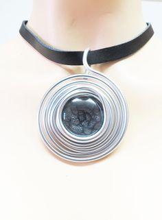 Leather And Silver Leather And Silver Pendant by IrisKreshes