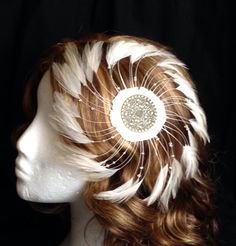 A personal favorite from my Etsy shop https://www.etsy.com/listing/241407115/ivory-white-spiral-feather-and-bronze
