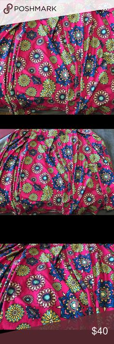 2xl Lularoe Madison Skirt Brand new with tags. Bnwt.  Size 3x. Xxxl. 3xlg Lularoe Madison Skirt   Pink background with yellow, green, blue, light pink and light tan.   T-shirt material. Madison's have pockets!!! LuLaRoe Skirts A-Line or Full