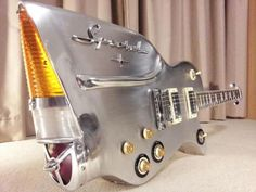 STRANGE MUSICAL EQUIPMENT - ELECTRIC GUITAR SHAPED LIKE 1957 CHEVY TAILLIGHT FIN!