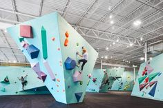 Faceted structures and colourful holds form climbing walls in Minneapolis