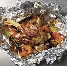 LAMB SHANKS EN PAPILLOTE WITH LEEKS, CARROTS, ROSEMARY AND ORANGE *Large skillet . http://www.finecooking.com/recipes/lamb-shanks-en-papillote-leeks-carrots-rosemary-orange.aspx