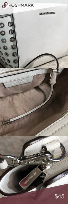 Michael Kors White leather Bag🎉 4 1/2in wise, 7in high, 9in long. The leather and seems are in great shape but the color looks a little dingy or something. I took a close up picture. It's hard to notice unless your close but a good cleaning would suffice I would say. The strap can extend to 47in. Michael Kors Bags Crossbody Bags