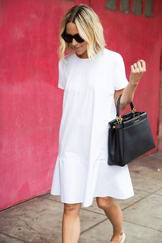 White dresses and little black handbags.