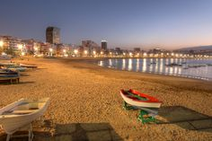 Photo about Twilight by the Las Canteras beach along the city of Las Palmas de Gran Canaria, Spain. Image of canaria, urban, palmas - 18429698 Best Beaches In Europe, Beaches In The World, Tenerife, Canario, Canary Islands, Spain Travel, Adventure Awaits, Beautiful Landscapes, Night Life