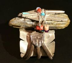 Left side to Eagle Head Carved Bracelet with Mask and three claws. Michael Kirk, Isleta Pueblo, NM.