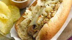 Milwaukee Dogs - Enjoy these cheesy bratwurst hot dogs topped with sauerkraut, onion and mustard – a delicious dinner.