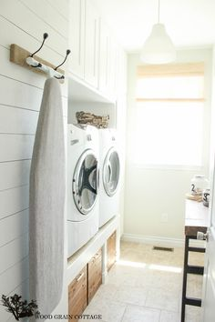 DIY: Laundry Room Plank Wall  (I would LOVE to have my washer + dryer up this high!)