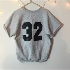 "Sweater Jersey Top Super soft and comfortable fit. Has a jersey style number ""32"" on the back of the shirt. The front is blank. Super cute and good for anyone small-medium. Not Brandy Melville Brandy Melville Tops Tees - Short Sleeve"