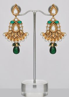 $16.00  Save: 50% off  Enhance your beauty wearing this stylish and latest fashion beautiful pair of Indian Polki earrings with intricate golden designing & craftsmanship. Studded with sparkling white & green color small stones & pearls all over & finished with a crystal drop. Be a fashion icon with this pair of Indian Polki Earrings !! Length of the earrings is 2.6 Inches