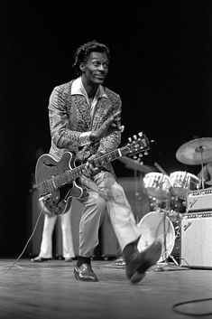 Rock and Roll pioneer Chuck Berry duck walks onstage at the Berkeley. - - Rock and Roll pioneer Chuck Berry duck walks onstage at the Berkeley Community Theatre in May, 1969 in Berkeley, California. Music Rock, My Music, Music Lyrics, Janis Joplin, Chuck Berry Duck Walk, Rock N Roll Baby, Rock And Roll Bands, Hard Rock, Lemmy Kilmister