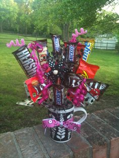 Candy bouquet made for a birthday.  Hot glued the candy bars to skewers.  Used ribbon to tie the middle of the bagged candies into bowties and glued to skewers ...stuck in a coffee mug and embelished with ribbon and pipe cleaners.