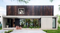 Argentinian architecture firm V2 Arquitectos has stacked a charred wood volume on top of a concrete structure to form a residence outside of Buenos Aires. Exposed Concrete, Concrete Wood, Concrete Floors, Green Terrace, Charred Wood, Wood Steps, Cedar Homes, Concrete Structure, Concrete Houses