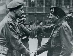 A photographer of the Belgium film unit snaps Montgomery congratulating Colonel Piron of the Piron Brigade in Brussels on the liberation of the city.