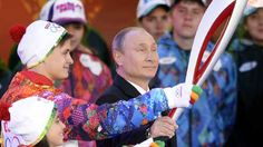 Russian President Vladimir Putin handles a torch in Moscow on October 6, 2013, to start the relay across Russia, as the Olympic Flame for the XXII Winter Olympic Games Sochi 2014 arrived in Russia . AFP PHOTO / ALEXANDER NEMENOV (Photo credit should read ALEXANDER NEMENOV/AFP/Getty Images)