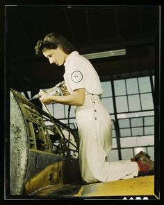 """WWII women in wartime photo.  """"Oyida Peaks riveting as part of her NYA training to become a mechanic at the Naval Air Base, in the Assembly and Repair Department, Corpus Christi, Texas.""""  http://Duster.me"""