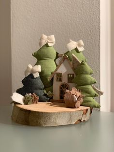 The wooden cottage with Christmas trees is built on a wooden stump. Winter Christmas, Christmas Tree, Wooden Cottage, Baby Hair Accessories, Floating Shelves, Christmas Decorations, Inspiration, Home Decor, Christmas Decor