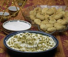 Semolina Dessert (Maamuneeya), front, is sinful with its whipped cream and pistachios.