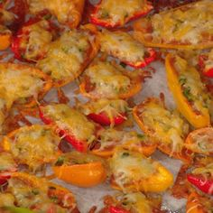 EveryGirl Nachos 1 bag of 20 mixed sweet mini peppers (yellow, orange, red) 1 tablespoon olive oil 1 large onion, diced 1 jalapeño pepper, chopped to add taste  1 1-ounce bag taco mix 1 16-ounce can refried beans 1 cup shredded mixed taco cheese  - See more at: http://www.rachaelrayshow.com/recipe/17733_EveryGirl_Nachos/index.html#sthash.TiCcmLzo.dpuf