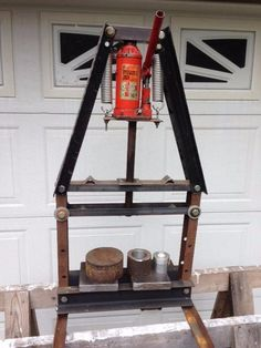 Shop Press by wvdirtbiker -- Homemade shop press constructed from surplus steel, a 5-ton bottle jack, and porch swing springs. http://www.homemadetools.net/homemade-shop-press-21