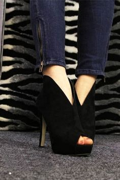 The high heels crafted in suede and rubber, featuring v-vamp detailing, a zip fastening to the reverse, peep toe, high platform and stiletto.$57