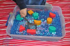 Fine Motor Skills, Shapes, Colors, Sensory Stuff - this great idea has lots going on.