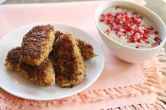 quinoa crusted chicken fingers with pom dipping sauce
