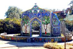 The Bottle Chapel was constructed with over 4000 colorful glass bottles, metal sculptures, and mosaics as a tribute to Minnie Evans. Wilmington, NC.