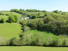 Down Farm, home of Ladybird Barn and Copper Kettle Cottage seen from across the valley. http://www.lovenorthdevon.com/northdevonholidays.html