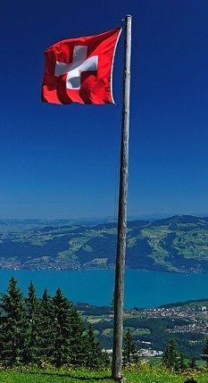 Flag of Switzerland - A generalization of the coat of arms of canton Schwyz, one of the three founding members of the Swiss confederation back in 1291.