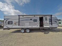 """FAMILY ESCAPE TO NATURE!!!  2017 Forest River Salem 30QBSS The bunkhouse has a small dinette that's great for crafts and board games! The master bed lifts up on struts to reveal a large storage area underneath. Cook the meat, boil the potatoes, and simmer the gravy at the same time on the 3-burner cooktop! This unit is 33' 2"""" long and weighs 6,634 lbs. dry. Give our Salem expert Kim Frarey a call 517-795-9834 for pricing and more information."""