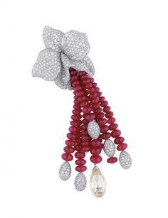 Caresse d'Orchidées par Cartier brooch. Platinum, rubies, brilliant-cut diamonds. PHOTO: Vincent Wulveryck © Cartier 2011