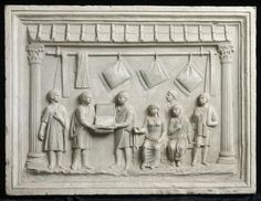 Relief sculpture showing a Roman shop, with customers buying pillows.