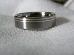 Titanium Ring with Double Silver Inlay Pinstripes. $55.00, via Etsy.