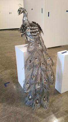 For her senior project at Northern Michigan University, Redditor liddlenomnom made this awesomely shiny life-size peacock using metal found objects. The Department of Exceptional Upcyling wishes they could display it in their office.  The project took just over 120 hours of work and required about $50 in materials, including lots of spoons, 1300 ft of wire, one gravy boat, and a portable vegetable steamer. The completed piece weights 23 lbs, 9 of which make up that splendid tail, which is…