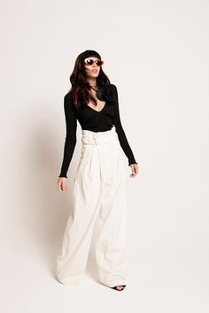 black long sleeved top, White wide legged trousers H&M, black sandals