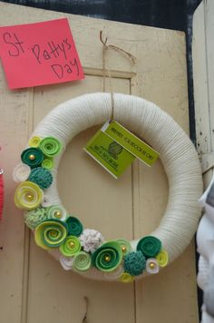 Yarn Wreath - ST. PATRICK'S DAY - 12 inch White Yarn Covered Straw Wreath with Handcrafted Felt Flowers and Gold Accents. $45.00, via Etsy.