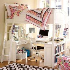 Lofted bed. Desk, mirrored vanity and bookshelves below.