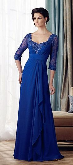 3/4 length lace sleeves and lace bodice with a flattering waist line. The deep royal blue is a charming choice in color.