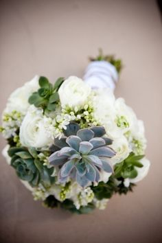 bridal bouquet could also be white flowers with some succulents. by daisy