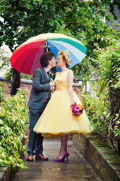 Yellow Candy Anthony wedding dress and rainbow wedding umbrella.